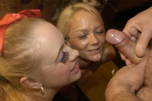 Two hot blondes get their faces plastered in cum